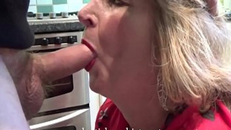 British mature wife and m. Rosemary gives upskirt panty views before swallowing a huge load of spunk in her own kitchen